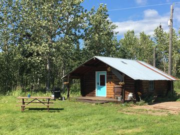 Stunning view of the mountains at authentic Frontiersman Cabin, full kitchen