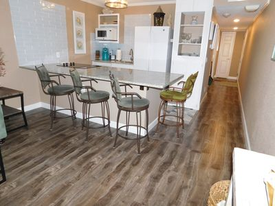 Open concept Kitchen/Living room. Spacious counter with seating.
