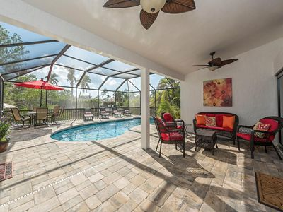 Photo for Walk to the Beach - 4 Bedroom Pool Home on the Canal