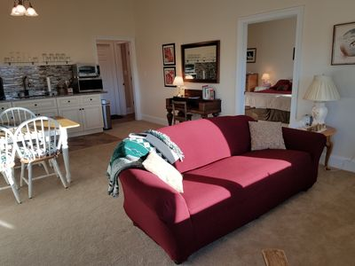 view of living room, king bed, kitchen/dining area