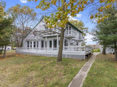 Photo for Outstanding lake home with wonderful sunsets, hard sand shore on full rec lake