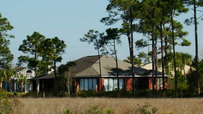 View from the beach of the back of the home, and the serene wetlands.