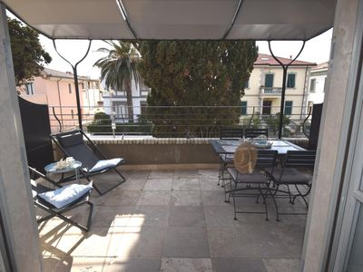 Photo for Refined Apartment with terrace and parking space very close to the sea