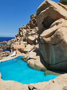 Photo for Villa immersed in the rock, swimming pool with sea water, private access to the sea