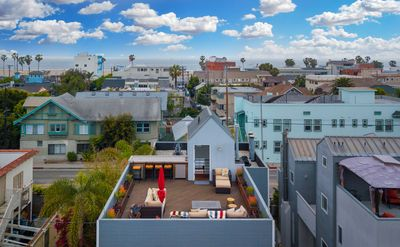 Photo for New Listing! Elegant Duplex w/ Rooftop Deck & City Views — 1 Block to Beach
