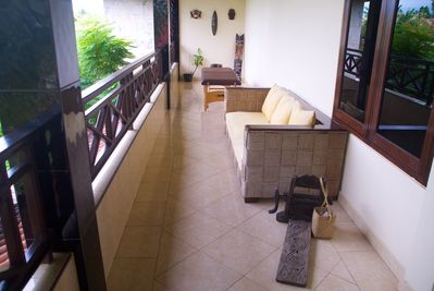 Secluded upstairs verandah with massage table
