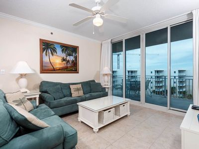 Photo for Gorgeous tropical condo on Okaloosa Island! Steps to beach! Free beach chairs! Lazy river on-site!