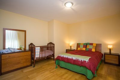 Bedroom 1 with large double bed (king size) and crib