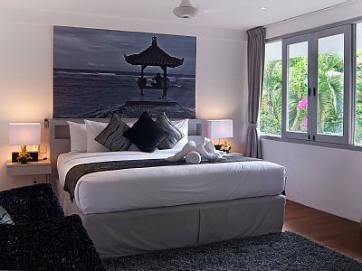 Spacious bedroom offers tropical outlook