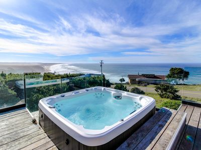 Photo for Oceanfront home with a private hot tub & gorgeous deck!