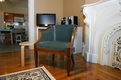 Sneak peek of the mantle and fireplace behind this comfortable chair.