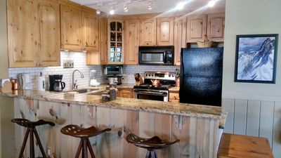 Modern kitchen with breakfast bar and everything you need to cook in and relax!