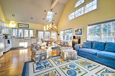 Large windows and soaring ceilings enhance the open floor plan.