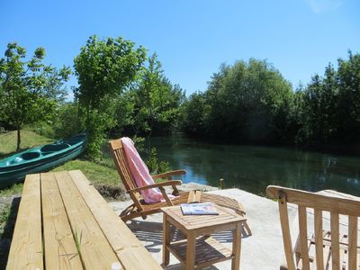 Photo for A small paradise by the river with heated pool