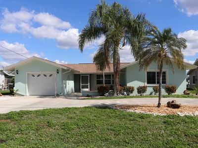 Photo for 3 Bed 2 Bath Pool Home on Direct Access Canal w. Boat Lift - PRIME LOCATION!!