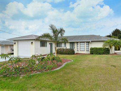 Photo for Spacious waterfront pool home less than 2 mile from the Gulf of Mexico
