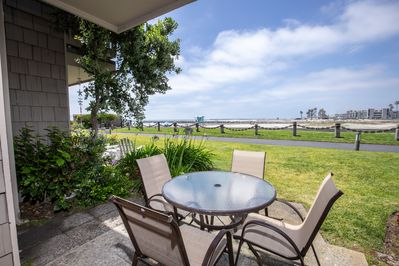 Enjoy outdoor living and dining with your ocean and harbor view patio and grassy area.