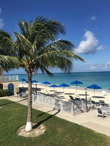 Photo for 34 Steps to GORGEOUS Seven Mile Beach - Beachfront at Cayman Reef Resort