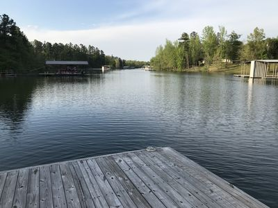 Photo for Located on full time water with boat house, swim platform, paved roads no stairs