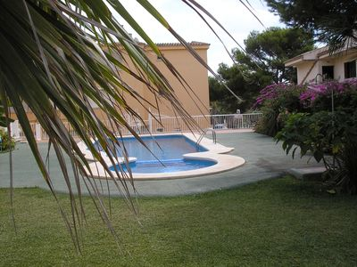 Photo for Apartment for two with communal pool 200 meters from the beach