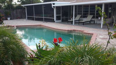 Photo for Private Retreat with Heated Pool and Large Screen Porch and Patio