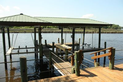 Double, covered dock with two lifts and fish cleaning station