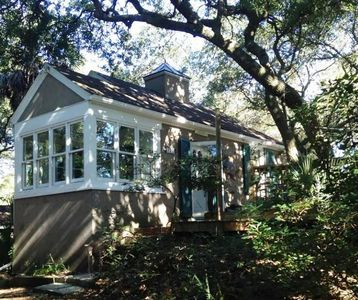 Photo for Romantic, cozy cottage nestled amongst live oaks & palms, a block from beach.