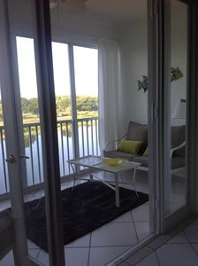 Sliding doors opens up glassed in Lanai,  French doors from living room to Lanai