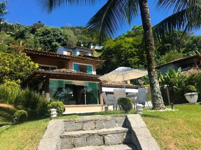 Photo for Comfortable house with private beach, pool and private dock deck.