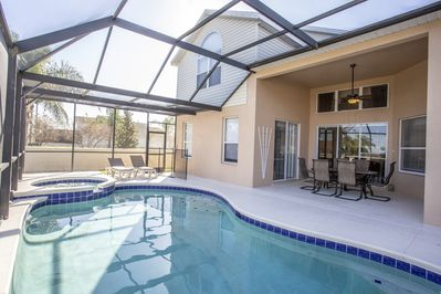 OUTSIDE PATIO W POOL AND JACUZZI
