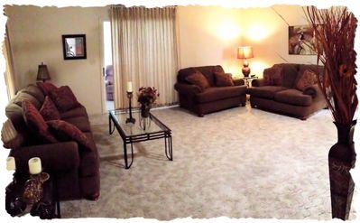 Spacious living area, comfy sofa, loveseat and over-sized chair.