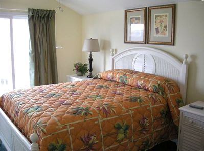 Upstairs Queen Bedroom with Large Upper Deck & Oceanview Out Window