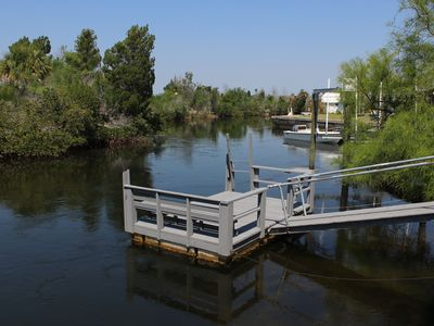 "Photo for Dolphin Cove Getaway -  3 bedroom waterfront, floating dock, with water ""toys""!"