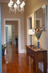 Polished floorboards in hall & kitchen