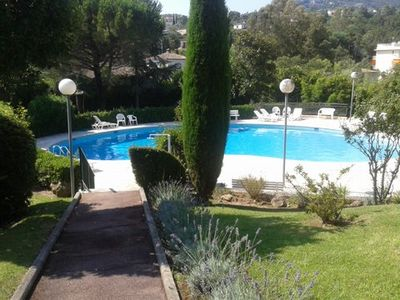 Photo for Nice apartment with large terrace and garden, garage and swimming pool!