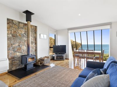 Photo for Absolute waterfront, set above the scenic rocks of Great Oyster Bay. Fireplace.