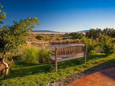 Teak bench in front of the cottage with expansive views of the three mountains