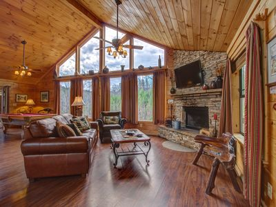 Photo for Gorgeous dog-friendly cabin w/mountain views, hot tub, sauna, pool table & more!