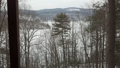 Winter view of Candlewood Lake and surrounding mountains from deck