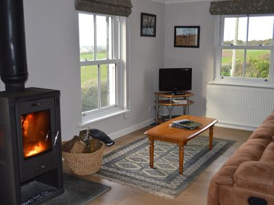 Photo for Luxury apartment with stunning views, wood burner, central heating and a garden