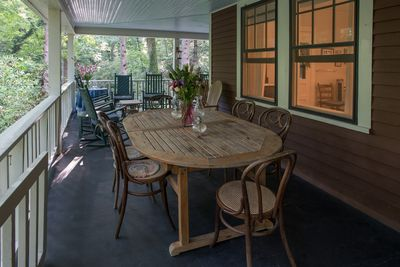 Huge wrap around porch on the main level w/rocking chairs, swing, and tables.