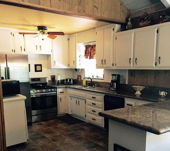 Kitchen w/ 5 burner stove & refrigerator w/ice maker & water dispenser