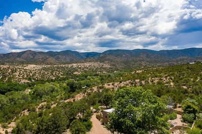 360 degrees of views.Spectacular mountain & mesa views surround this tranquil 5 acre Santa Fe adobe. Escape from daily routine and busy everyday life to this charming oasis!