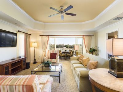 Photo for Third Floor Condo, Upgraded TV`s and Golf Course Views! Minutes to Disney!
