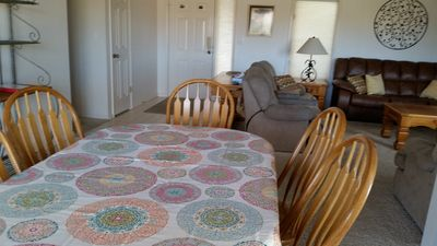 Dining room: table extends to seat 8, extra chairs, high chair in closet