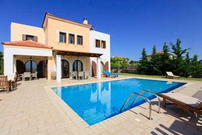 Private swimming pool with terrace and garden area