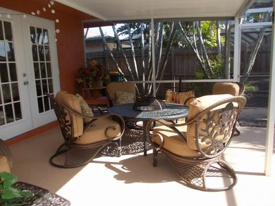 Many more chairs and a sofa on patio