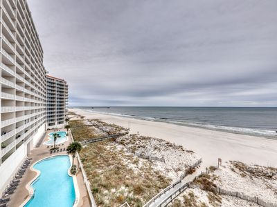 Photo for Gulf-front condo w/ private balcony & shared pools, hot tubs & gym!
