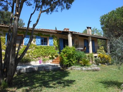 The back of the property featuring outdoor sitting overlooking the olive grove