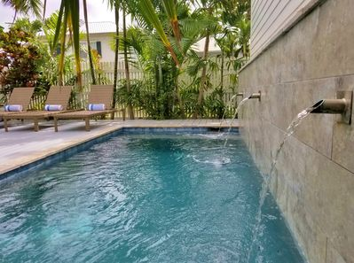 Immaculate pool area with lush, tropical surroundings.